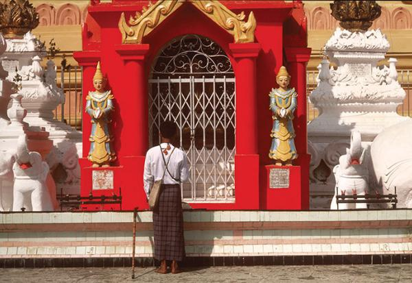 Man standing before a Temple in Burma